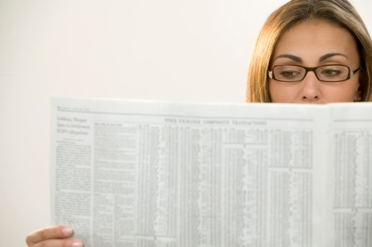 Woman Reading the Business Section